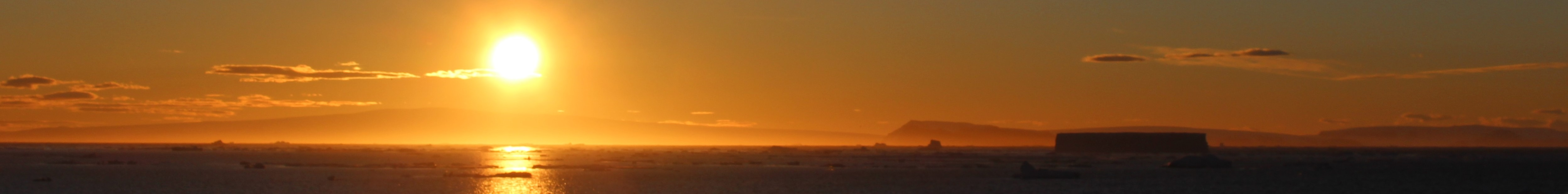 Sunset and icebergs in the Weddell Sea. The Small Cruise Ship Collection
